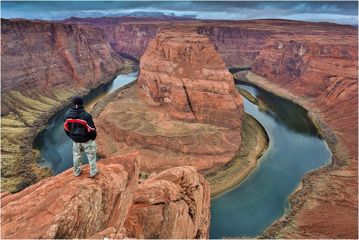 standing on the cliffs at horseshoe bend, az