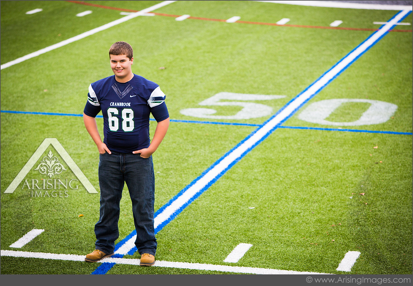 michigan sports senior pictures on a football field